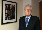 Former Prime Minister Monti posing with James Tobin portrait