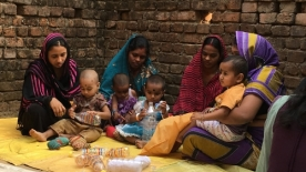 Mothers and children participate in a playgroup as part of an experiment in Odisha, India studying whether a promising early childhood development intervention can become effective policy.
