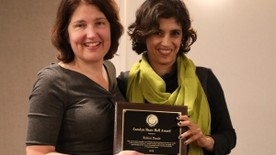 Judy Chevalier presenting Rohini Pande with the Carolyn Bell Shaw Award at the the annual CSWEP business meeting and award ceremony on Jauary 4, at the 2019 AEA Meeting in Atlanta