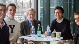 Robert Shiller sitting with students