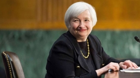 Janet Yellen sitting at a desk