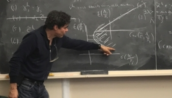 John Geanakoplos showing graph on the chaulk board
