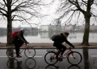 Two bicyclist riding in rainy weather
