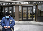 Visitors wearing surgical mask in front of New York State Department of Labor building