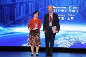 Xiaohong Chen andGregory C. Chow on stage at 2017 Chinese Award Ceremony